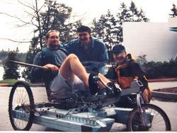 Brian sitting on original amphibike with friends Hal and Joe