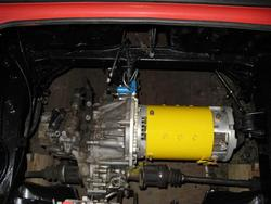 motor and transmission assembly installed into car.