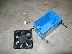 Parts for creating the ventilation fan: one electrical outlet box and one 12-volt computer cooling fan